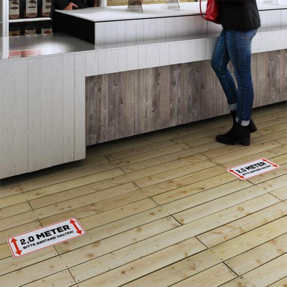 Fußbodenaufkleber Abstand halten Innenbereich